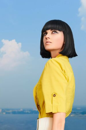 bob: beautiful young woman with bob hairstyle.summer girl over blue sky