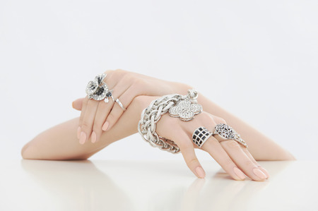 Beauty hand with jewelry and manicure.elegance woman hand with rings and bracelet