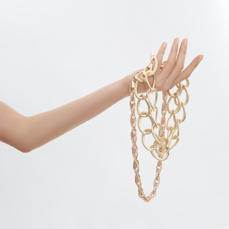 Beauty female hand with gold jewelry.elegance woman hand