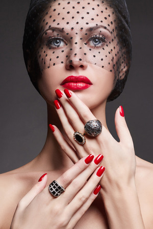 beautiful young woman with black veil and jewelry.red lips,make-up,fashion beauty girl Stock Photo