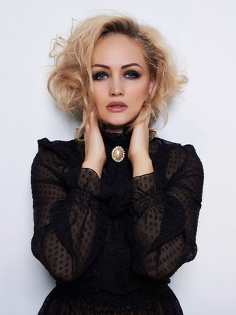 beauty Blonde girl with curly hairstyle. Beautiful passion model girl