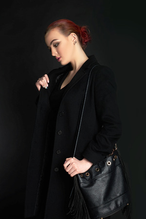 fashionable Beautiful Woman in topcoat and leather handbag.winter style lady Stock Photo