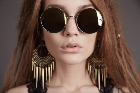 beautiful young woman in glasses. trendy sunglasses