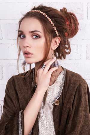 stylish hipster girl with hairstyle and accessories.fashion beautiful young woman