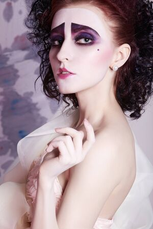 Strange bride woman with makeup on her face.Scenic image beauty girl actress Stock Photo