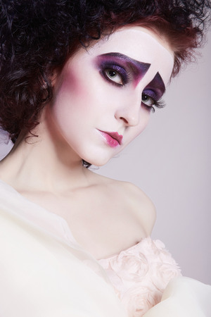theatre masks: Strange woman with make-up on her face.Scenic image beauty girl actress