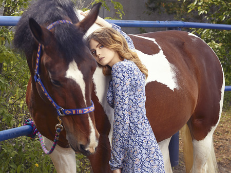 Beautiful girl walks with a horse.beauty young woman and horse