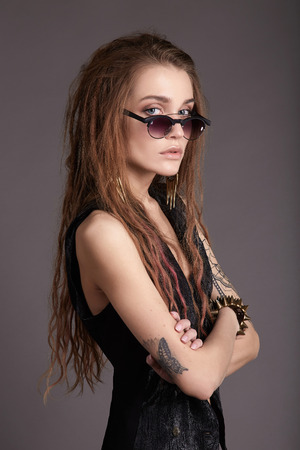 beautiful young woman with tattoo.fashion beauty biker girl in glasses