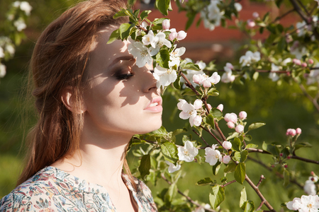 sensual Beautiful girl in Forest flowers.Beauty young woman in Apple-tree flowers Stock Photo