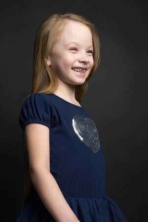 beautiful little girl with healthy long hair.beauty smiling child Stock Photo