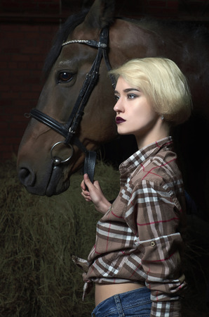 Beautiful young woman with a horse.beauty blond girl and horse