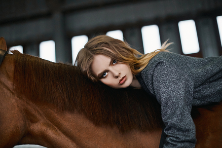 Beautiful girl in hat on horse.beauty young woman and horse