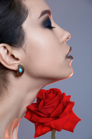 pure make-up woman with red rose flower.female face and flower Stok Fotoğraf
