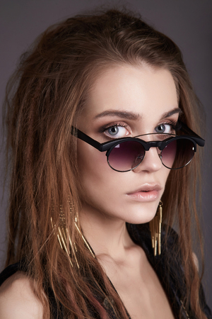 beautiful young woman in glasses. girl in accessories and trendy sunglasses