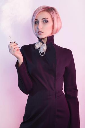 beautiful blond girl in long black dress,smoke a cigarette. smoking woman