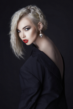 beautiful blond sexy woman fashion portrait.Girl with colored healthy hair and make-up. beauty salon hairstyle