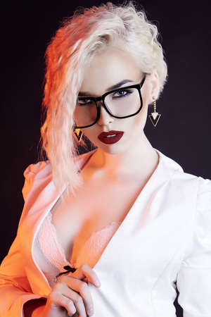 sexy beautiful blonde woman in glasses.passion sexy teacher woman