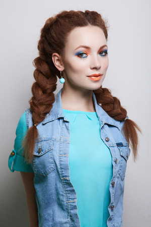 happy beauty girl with braids hairstyle. beautiful smiling woman with color make-up Stock Photo