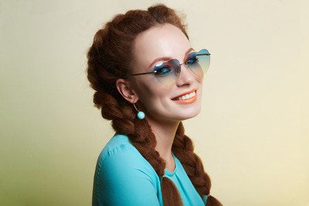 beauty girl in trendy glasses. beautiful young woman with colorful make-up
