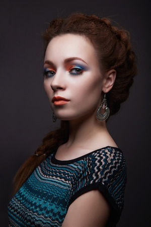 beauty girl with braids hairstyle. beautiful young woman with colorful make-up