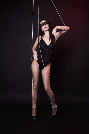 beautiful body puppet woman in under control. sensual doll girl in sexy underwear