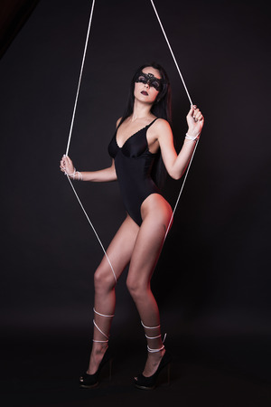 beautiful body puppet woman in under control. doll girl in sexy underwear Stock Photo
