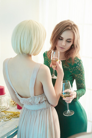 Two beautiful women drink champagne. two beautiful sexy girls. home party. lovely couple in festive interior Stock Photo