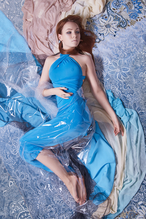 beauty woman in blue dress on pattern. sensual beautiful girl in colored fabrics