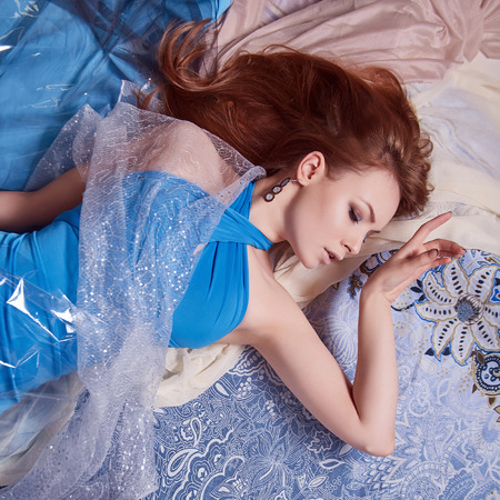 Beauty Woman in blue Dress on Pattern. sensual Beautiful Girl in colored clothes