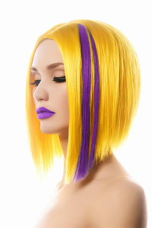 Yellow purple Hair. Haircut. Beautiful Girl with Color Hair. Hairstyle. Bob. Fringe. Profile Portrait of Fashion Beauty Woman Stock Photo
