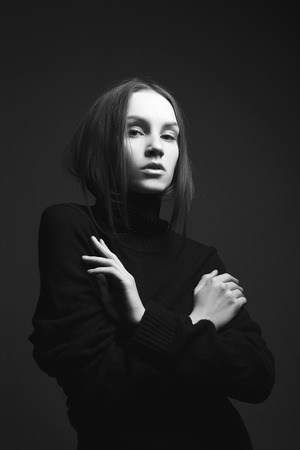 fashion portrait. Beautiful young woman in black. girl in the dark
