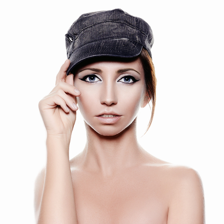 Naked Girl in Cap. Beauty Make-up sensual Woman. Isolated portrait Stock Photo