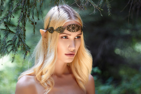beautiful elf girl. fantasy young woman in woods