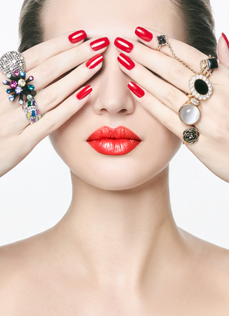 beautiful young woman with jewelry rings. beauty girl with make-up and manicure