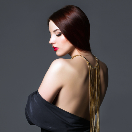 beautiful back of woman in a black sexy dress. beauty Girl with a necklace on her back Stock Photo - 105515657