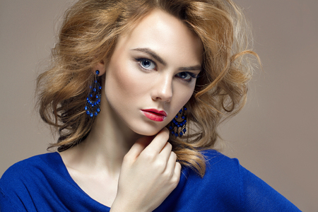 beautiful young woman in jewelry. Healthy hair beauty girl with make-up