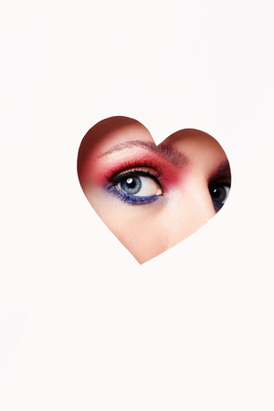beautiful woman eye inside heart.beauty colorful male-up.love,Valentines Day concept Stock Photo