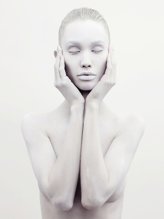 Body art nude woman. conceptual halloween make-up. painted white powder skin beauty girl Stockfoto