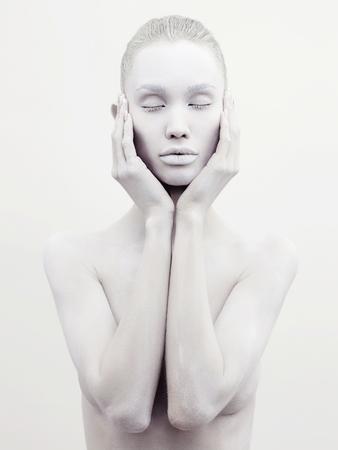 Body art woman. conceptual halloween make-up. painted white powder skin beauty girl Stock Photo