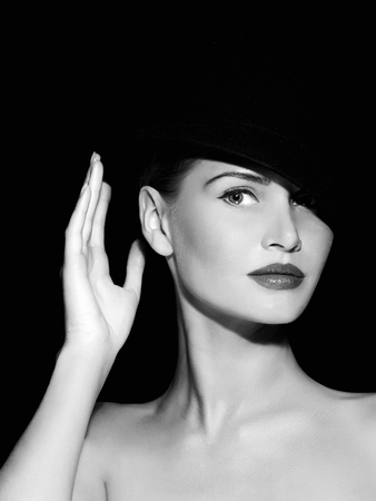 Fashion beautiful young woman in hat. Black and white portrait of Lady Stock Photo