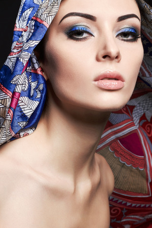 fashion portrait of beautiful young woman under hood. Girl with colorful Make-up Reklamní fotografie