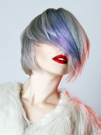 young Woman with colorful Hair, dressed in White Fur. fashion Beauty Model Girl with trendy color hair and red Lips Stock Photo - 107010090