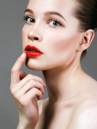 beauty female face. young woman cares for face skin. beautiful girl with clean fresh face. Make-up, Skin care concept