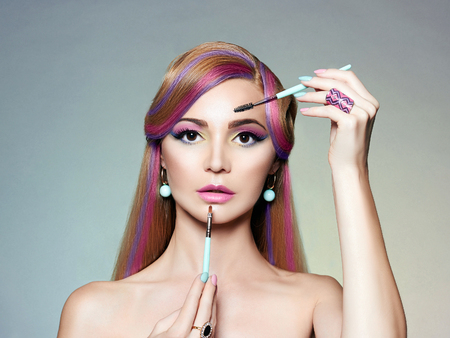 beauty portrait. blonde woman Applying Make-up. Beautiful Girl with colorful Hair Reklamní fotografie