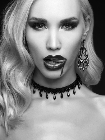 beautiful halloween make-up blond woman. vampire girl