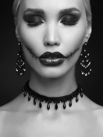 beautiful halloween make-up blond woman. vampire girl Stock Photo - 109013324