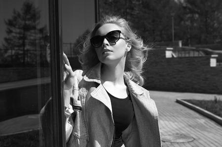 fashionable girl in sunglasses. Lifestyle summer walking beautiful young woman Stock Photo - 109006645