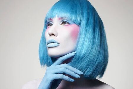 Beautiful girl with Blue Hair and art make-up. Fairy beauty young woman