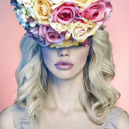 fashion portrait of beautiful blond young woman in floral hat.spring colorful beauty girl with roses flowers