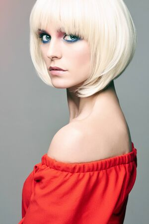 Beautiful girl with Blond Hair and bob Haircut. beauty young woman